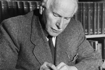 Psychiatrist Carl Jung at Desk Writing